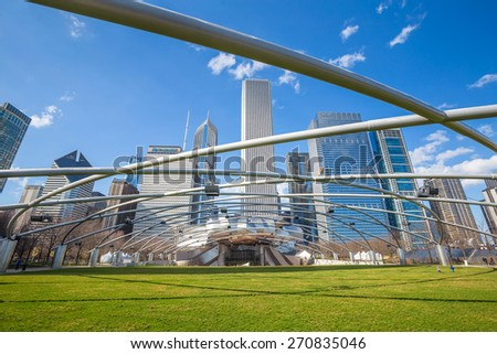 CHICAGO-April 10:Jay Pritzker Pavilion with high modern buildings in winter at Millennium Park on April 10, 2015 in Chicago, IL USA. Pavilion hosts concerts and events by capacity for 11,000 people.