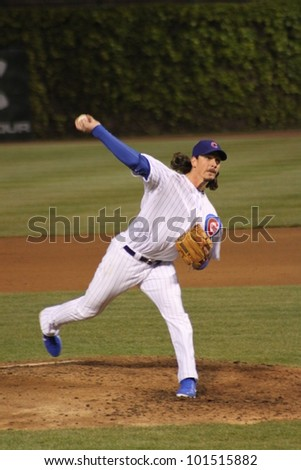 CHICAGO - APRIL 25: Jeff Samardzija of the Chicago Cubs pitches against the St. Louis Cardinals at Wrigley Field on April 25, 2012 in Chicago, Illinois. - stock photo
