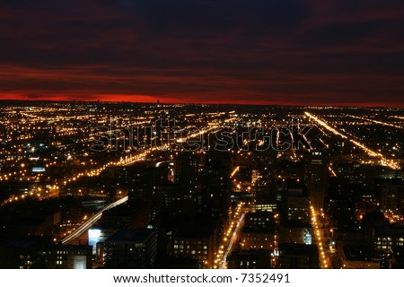 Chicago at Night with the Setting Sun, looking west - stock photo