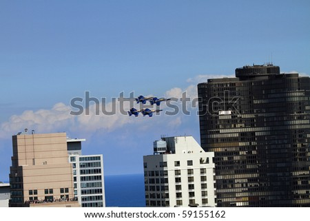 CHICAGO - AUGUST 14:  The Chicago Air and Water Show featuring military aircraft doing precision flying over Lake Michigan, and civilian airplanes doing aerobatics August 14, 2010 in Chicago. - stock photo