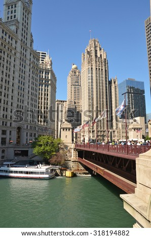 Chicago - August 12: view of Michigan Avenue Bridge and the Tribune Tower in Chicago, USA, on August 12, 2015. The bridge links the Magnificent Mile shopping area with the Loop District.  - stock photo