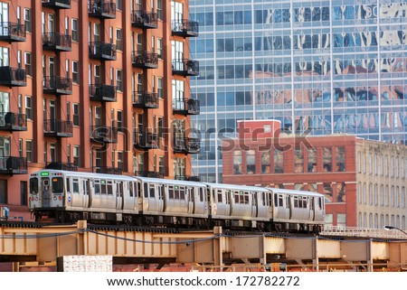 CHICAGO - DECEMBER 28: An elevated train passes through downtown Chicago on December 28, 2013 - stock photo