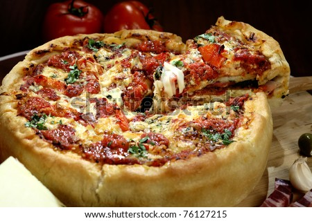 Chicago deep dish pizza arrange on the table - stock photo