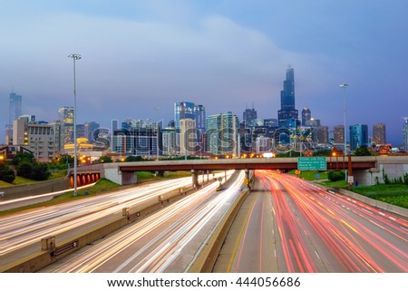 Chicago downtown skyline at twilight with highway and traffic. - stock photo