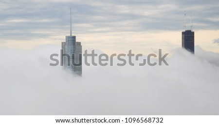 Chicago downtown skyscraper buildings above cloud fog