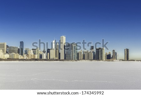 Chicago downtown view in winter scenery with snow and frozen lake - stock photo