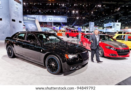 CHICAGO - FEB 9: A Mopar executive talks about the customizations to a Chrysler 300 at the 2012 Chicago Auto Show Media Preview on February 9, 2012 in Chicago, Illinois. - stock photo