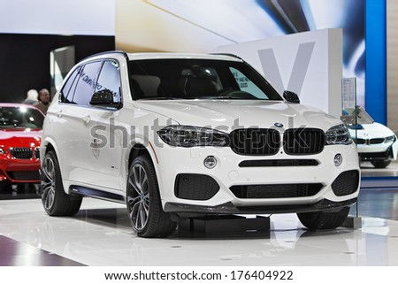 CHICAGO - FEBRUARY 7 : A BMW X5 on display at the Chicago Auto Show media preview February 7, 2014 in Chicago, Illinois. - stock photo