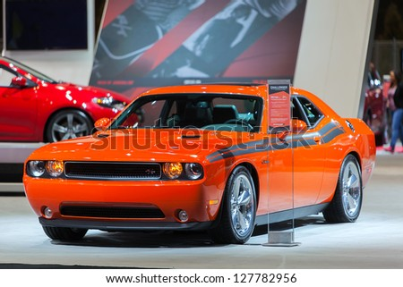 CHICAGO - FEBRUARY 8 : A 2014 Dodge Challenger on display at the Chicago Auto Show media preview February 8, 2013 in Chicago, Illinois. - stock photo