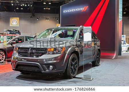 CHICAGO - FEBRUARY 6 : A Dodge Journey on display at the Chicago Auto Show media preview February 6, 2014 in Chicago, Illinois. - stock photo