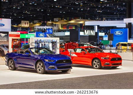 Chicago - February 12: A pair of Ford Mustangs on display February 12th, 2015 at the 2015 Chicago Auto Show in Chicago, Illinois. - stock photo