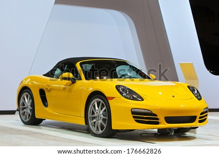 CHICAGO - FEBRUARY 6 : A Porsche Boxster on display at the Chicago Auto Show media preview February 6, 2014 in Chicago, Illinois. - stock photo