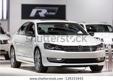 CHICAGO - FEBRUARY 8 : A Volkswagen Passat on display at the Chicago Auto Show media preview February 8, 2013 in Chicago, Illinois. - stock photo