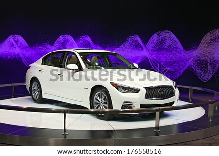 CHICAGO - FEBRUARY 6 : An Infiniti hybrid sedan on display at the Chicago Auto Show media preview February 6, 2014 in Chicago, Illinois. - stock photo