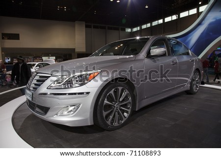 CHICAGO - FEBRUARY 12: Hyundai Genesis presentation at the Annual Chicago Auto Show February 12 2011 in Chicago, IL. - stock photo
