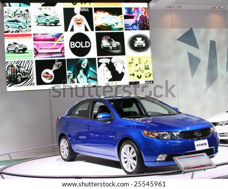 CHICAGO, FEBRUARY 18, 2009: Kia introduced the all-new 2010 Kia Forte at the 2009 Chicago Auto Show. Forte's trunk offers an impressive 14.7 cubic feet of cargo space, one of the largest in its class. - stock photo