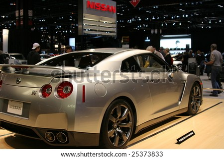 """CHICAGO - FEBRUARY 18 : Nissan launched the new GT-R in the U.S.A. as an""""ultimate supercar"""". The new 2009 NISSAN GT-R displayed at the Auto Show 2009 in Chicago, IL  February 18, 2009. - stock photo"""