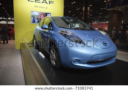 CHICAGO - FEBRUARY 12: Nissan Leaf presentation at the Annual Chicago Auto Show February 12 2011 in Chicago, IL. - stock photo