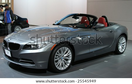 CHICAGO, FEBRUARY 18, 2009: The 2009 BMW Z4 as the first BMW Roadster with a retractable hardtop; the Z4 delivers 300 horsepower, performance and fuel efficiency. Displayed at the Auto Show 2009 in Chicago. - stock photo