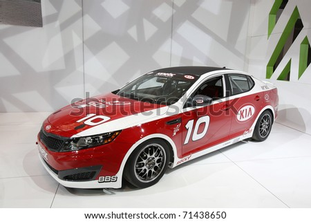 CHICAGO - FEBRUARY 15: The KIA race car presentation at the Annual Chicago Auto Show on February 15, 2011 in Chicago, IL. - stock photo