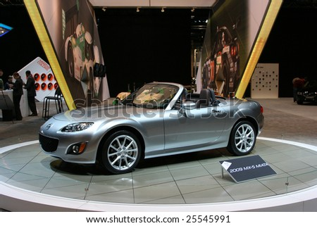 CHICAGO, FEBRUARY 18, 2009: The Mazda MX-5 receives new frontal features, crisper lines and flared fenders. It is the world's most popular convertible sports car. Displayed at the Auto Show 2009 in Chicago. - stock photo