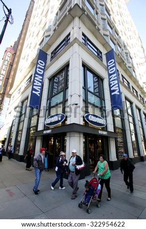 CHICAGO - FRIDAY, SEPTEMBER 25, 2015: Pedestrians walk past an Old Navy store in Chicago. Old Navy is a  clothing and accessories retailer owned by American  corporation Gap Inc.  - stock photo