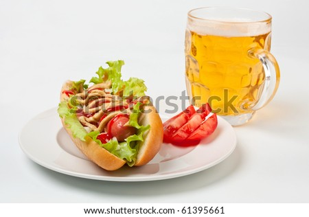 chicago hotdog and glass of beer - stock photo