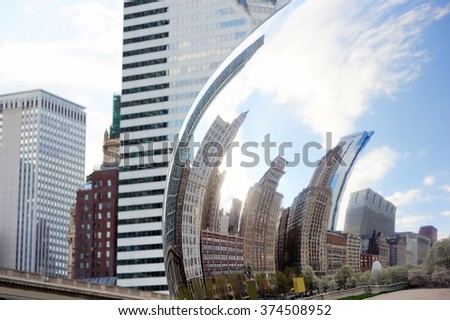 CHICAGO, IL - APR 23: Part of Cloud Gate and Chicago skyline on April 23, 2015 in Chicago, Illinois. Cloud Gate is the artwork of Anish Kapoor as the famous landmark of Chicago in Millennium Park