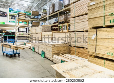 Chicago, IL April 2015: Wood stacked on shelving inside a lumber yard of a hardware store - stock photo