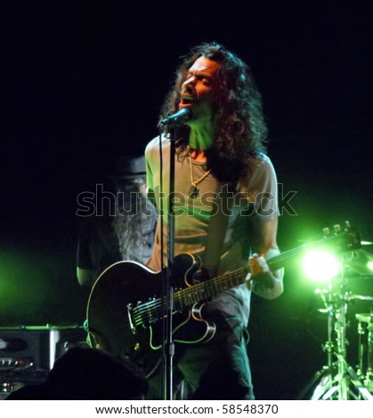 CHICAGO, IL - AUG. 5: Soundgarden perform their historic reunion concert on August 5, 2010 at the Vic Theater in Chicago. This is a warm-up for Lollapalooza. - stock photo
