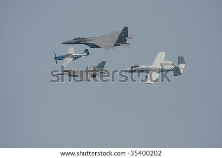 CHICAGO, IL - AUGUST 15: The Heritage Flight of different era aircraft at the Chicago Air & Water show featuring precision formation flying by military aircraft August 15, 2009 in Chicago, IL. - stock photo