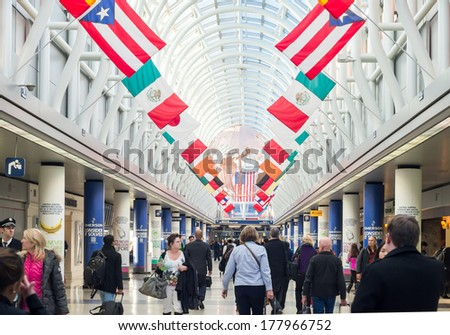 CHICAGO, IL - FEB 10 2014: Terminal 3 of O'hare Internation Airport on February 10th 2014. Terminal 3 Hall of Flags represents a country that American Airlines serves non-stop from O'Hare - stock photo