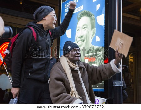 Chicago, IL - February 20 2016 : Among other people, an Asian-american and an African-american demonstrate their dissatisfaction of the trail process and conviction of NYPD officer Peter Liang.