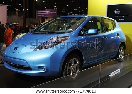 CHICAGO, IL - FEBRUARY 20: Nissan Leaf electric model 2011 at the International auto-show on February 20, 2011 in Chicago, IL - stock photo