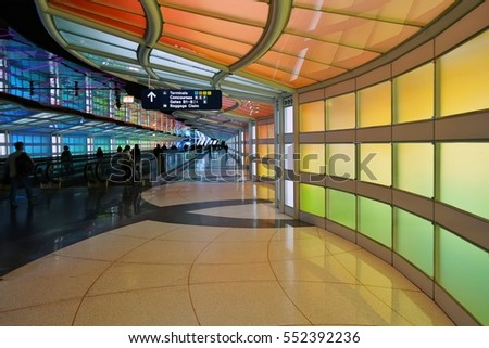 CHICAGO, IL -5 JAN 2017- The colored electric neon tunnel The Sky Is the Limit at Chicago O'Hare International Airport (ORD) connects the B and C concourses at the United Airlines (UA) terminal.