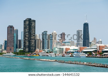CHICAGO, IL - JULY 1: View of the Chicago Harbor and Navy Pier with the skyline in the background as seen from Lake Michigan on July 1, 2013. - stock photo