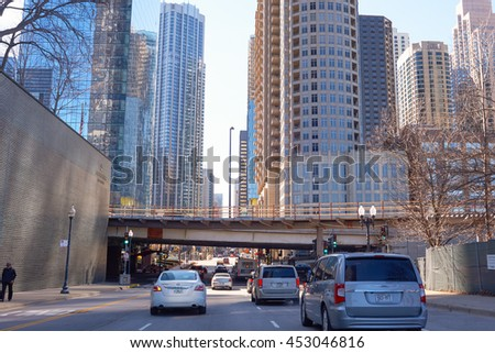 CHICAGO, IL - MARCH 25, 2016: Chicago traffic in the daytime. Chicago is the third most populous city in the United States.
