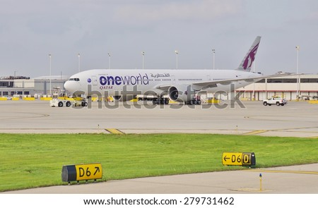 CHICAGO, IL -16 MAY 2015- A Boeing 777-300 from Qatar Airways (QR) painted in the livery of OneWorld Alliance at Chicago Oâ??Hare International Airport (ORD). QR joined OneWorld in 2013.  - stock photo