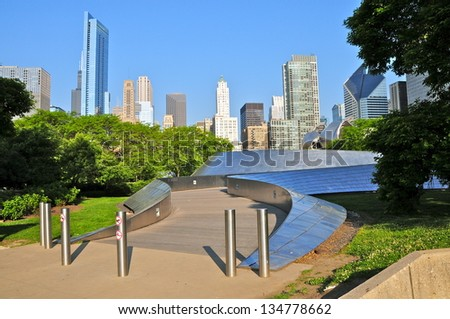 CHICAGO,IL - MAY 19: BP Pedestrian Bridge in millennium park, Chicago on May 19, 2012. The bridge spans Columbus Drive to connect Daley Bicentennial Plaza with Millennium Park, Designed by Frank Gehry - stock photo