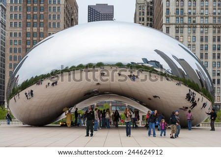 CHICAGO, IL - November 5: Cloud Gate and Chicago skyline on November 5, 2008 in Chicago, Illinois. Cloud Gate is the artwork of Anish Kapoor as the famous landmark of Chicago in Millennium Park. - stock photo