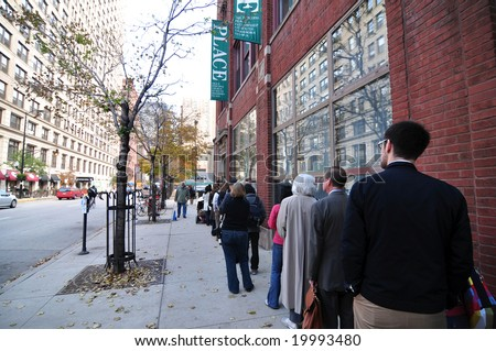 CHICAGO, IL - NOVEMBER 4: Voters wait outside a polling place on November 4, 2008 in Chicago, IL - stock photo