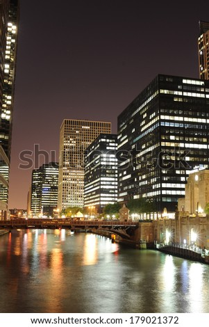 CHICAGO, IL - OCT 6, 2011: Chicago downtown at night on October 6, 2011 in Chicago, Illinois. Chicago is the third most populous city in the United States, after New York City and Los Angeles - stock photo