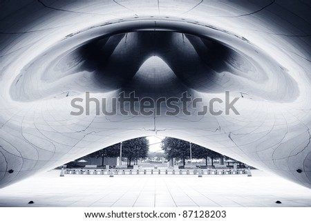 CHICAGO, IL - OCT 6: Cloud Gate with abstract curve shadow on October 6, 2011 in Chicago, Illinois. Cloud Gate is the artwork of Anish Kapoor as the famous landmark of Chicago in Millennium Park. - stock photo
