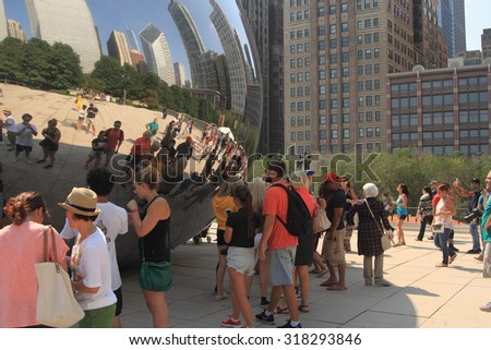 Chicago, IL - September 06: Millennium Park on September 06, 2015 in Chicago. People enjoying a walk at the bean sculpture at Millennium Park in Chicago, USA.