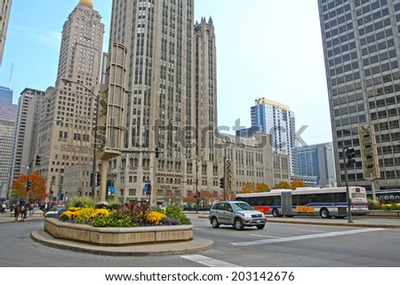 CHICAGO, IL, US - NOVEMBER 13, 2007: Chicago Tribute building on Michigan avenue of Chicago downtown. The Windy City is the third largest city in the U.S. and is a worldwide center of commerce. - stock photo