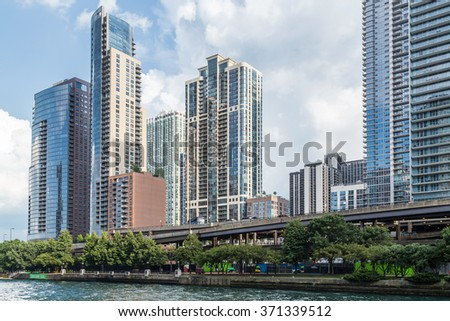 Chicago, IL/USA - circa July 2015: High-rise Luxurious Residential Buildings in Downtown Chicago along River Esplanade, Illinois - stock photo
