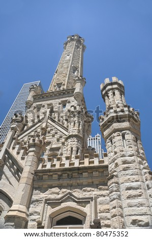 CHICAGO, ILLINOIS - JULY 25: Chicago Water Tower built in 1869 is on Michigan Avenue and is one of the few structures to survive the Great Chicago Fire of 1871. Chicago, Illinois July 25, 2010. - stock photo