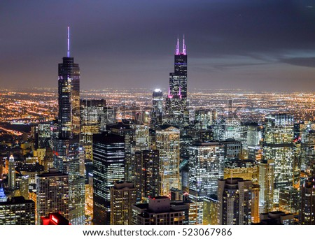 CHICAGO, ILLINOIS - OCTOBER 22, 2015 -   Aerial view of illuminated skyscrapers
