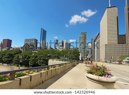 CHICAGO, ILLINOIS - SEPTEMBER 4: Millennium Park and partial skyline of Chicago, Illinois, on September 4, 2011. The park is a popular destination for tourists in the center of downtown Chicago. - stock photo