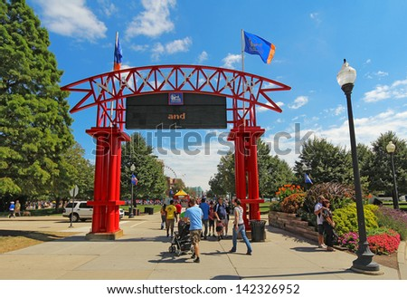 CHICAGO, ILLINOIS - SEPTEMBER 4: Tourists at the main entrance to Navy Pier in Chicago, Illinois on September 4, 2011. The Pier is a popular destination for tourists on the shoreline of Lake Michigan. - stock photo
